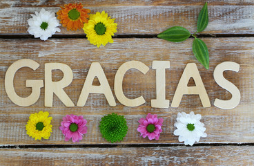 Gracias (thank you in Spanish) written with wooden letters