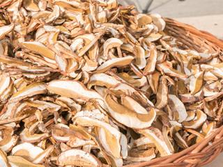 dried porcini mushrooms in wicker bowl