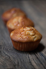 delicious homemade muffins over wooden board