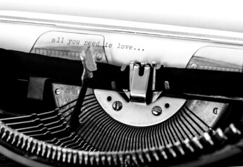 "Typewriter; ""All you need is love"" text typed on paper"
