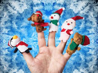 Christmas toys put on a hand