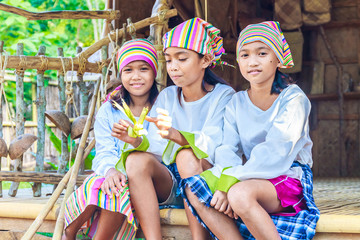 three young beautiful child girls in traditional clothes in bamb