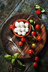 Tuinposter Buffel Cherry tomatoes, basil leaves, mozzarella cheese and olive oil f