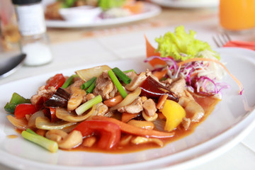 stir fried chicken with vegetables served on plate
