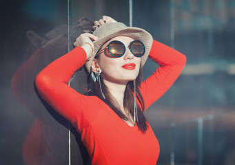 Young beautiful girl in hat and sunglasses enjoy sunlight