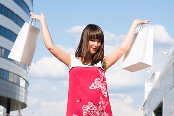 Beautiful young woman enjoys shopping