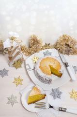 Festive pumpkin cake and Christmas decoration. Background bokeh