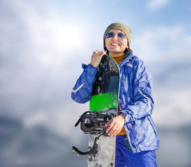Woman with snowboard on the bright blue sky background