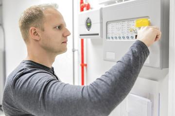 Technician test fire panel in data center
