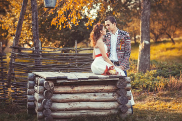 Bride and groom near the wooden well