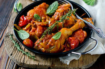 Chicken in tomato sauce with rosemary and thyme