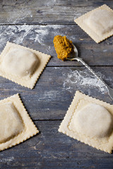 homemade stuffed with pumpkin ravioli big size on wooden table