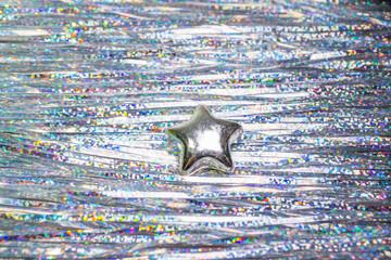 Silberstern im Lametta von oben