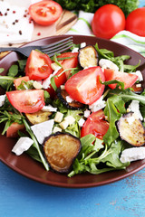 Eggplant salad with tomatoes, arugula and feta cheese,