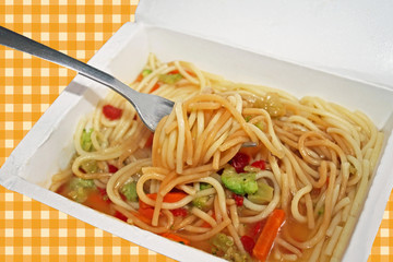 Microwaved meal of noodles, gravy and vegetables