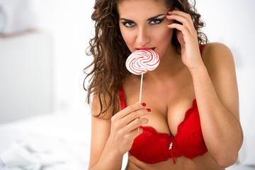 Seductive woman with lollipop