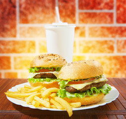 fastfood burgers, soda and fries