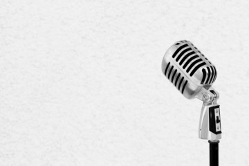 Silver vintage microphone in the studio on white wall background