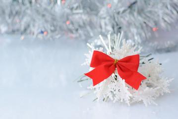 red bow on white snowflakes on the background bokeh glamorous