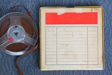 top view of old sound recording tape, reel to reel type and box