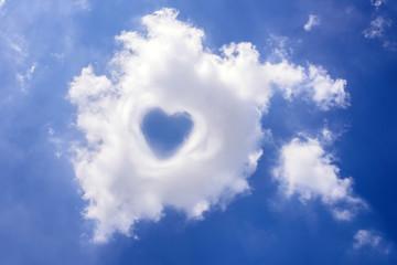 Heart in cloud on the blue sky
