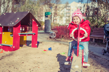 baby playing at the playground