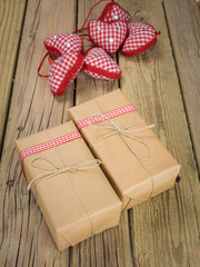 parcels wrapped in brown paper and string with red check decorat