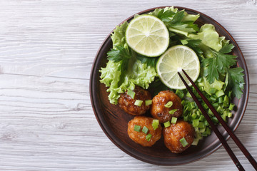 Fish balls in curry sauce on a plate top view of a horizontal