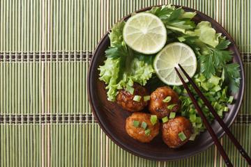 Asian fish balls with salad closeup. top view horizontal