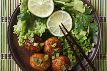 fish balls in curry sauce with lime top view