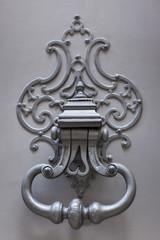 Old door knocker on a wooden door