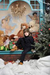 Christmas boy around Christmas tree with gifts