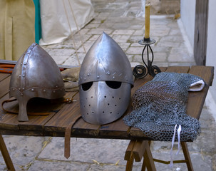Two different kinds of medieval helmets and iron mail