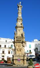 Spire of St. oronzo in the main square. Ostuni. Puglia. Italy