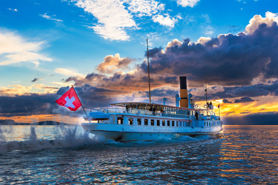 Ancien steam boat with swiss flag floating on the lake Geneva