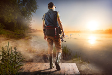 Printed roller blinds Fishing Young man fishing at misty sunrise
