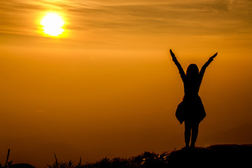 The success concept of silhouette of Young woman standing arms m