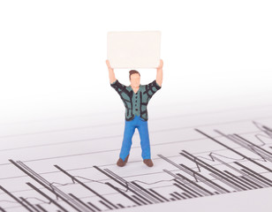 Tiny person demonstrating on a graph