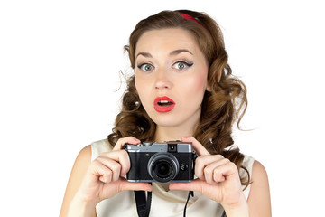 Photo of the surprised woman with camera