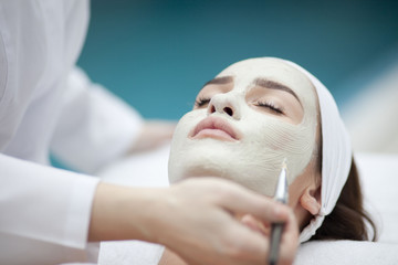 spa, resort, beauty and health concept - beautiful woman in spa