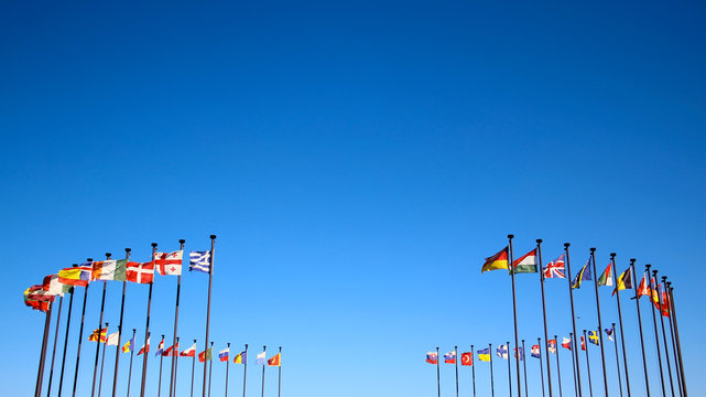 international flags against the sky