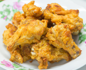Chicken wings on white dish.