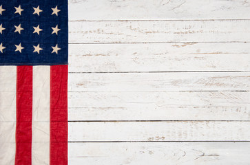 white wooden background with an American flag