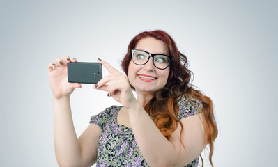 Funny viper girl with a smartphone on background
