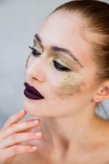 Fashion image with professional cosmetics.  skin and big lips