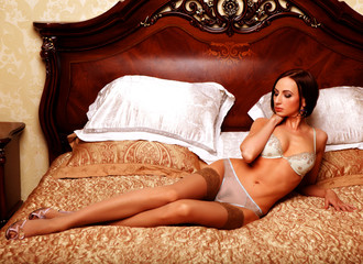 young elegant woman in bed