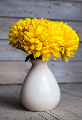 Flowers. Beautiful yellow chrysanthemum in a vase