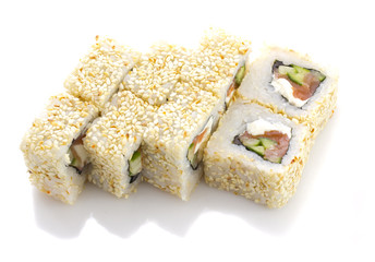 Sushi roll with salmon cheese and vegetables and sesame isolated