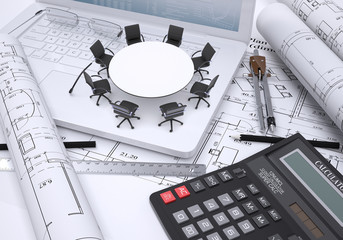 Miniature round table with chairs placed on laptop, calculator