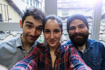 Three friends take a Selfie from the office